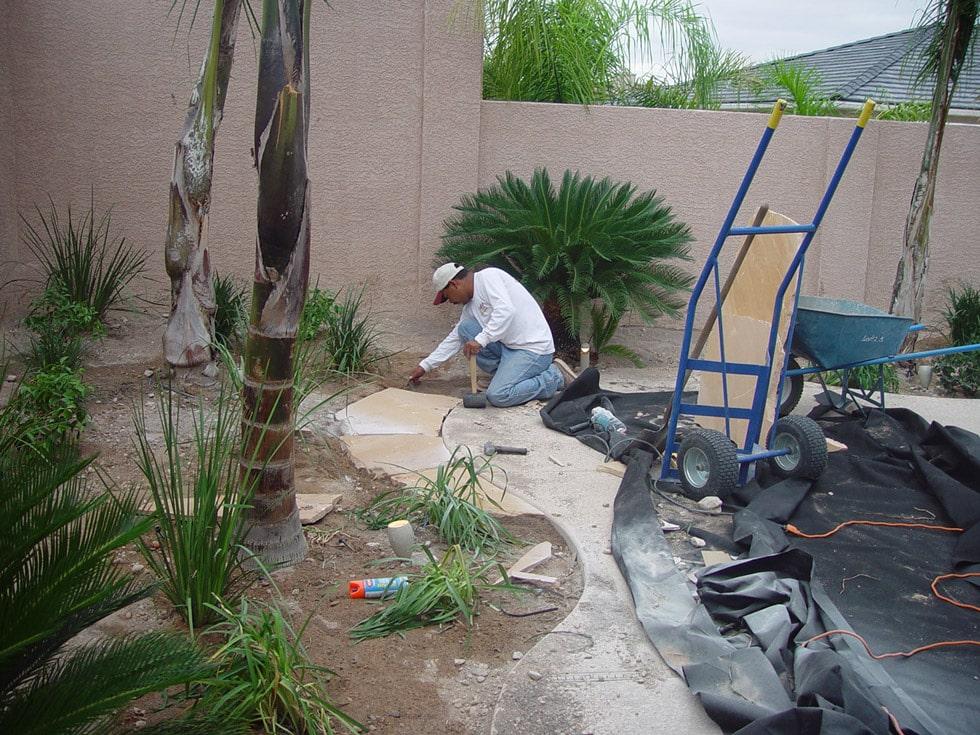 Landscaper installing irrigation system